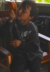 Nolan and his caramel apple